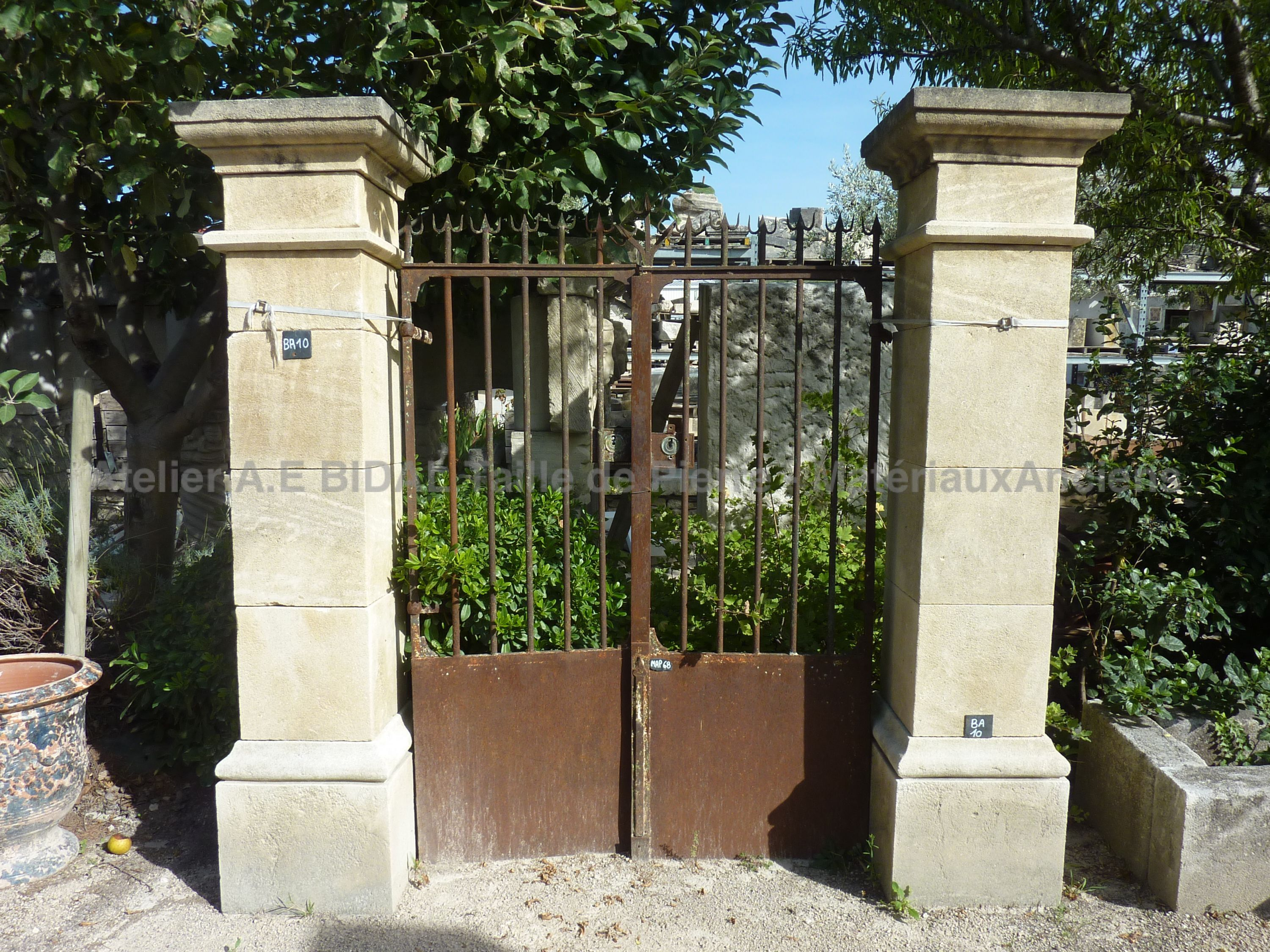 BA10 - Square pillars for portal carved in natural stone and aged by time