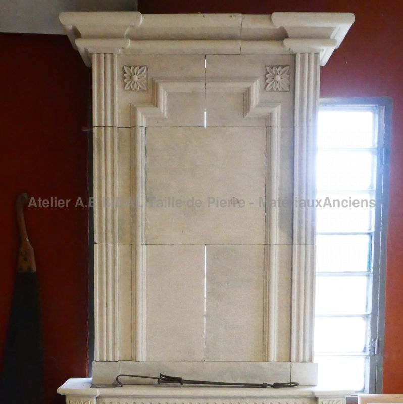 Fireplace carved in a stone quarried in France - Louis XVI style stone fireplace.