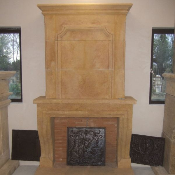 Elegant fireplace carve in limestone of Louis XIII-style.