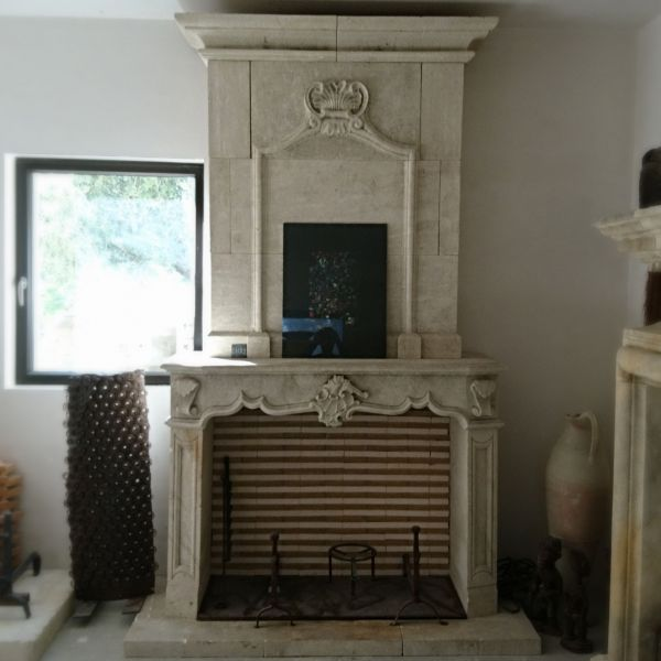 Very elegant fireplace with overmantle - a fireplace in stone of classical style.
