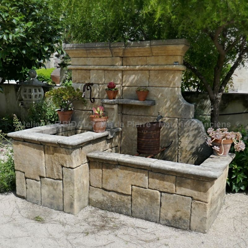 Large natural stone garden wall fountain | Stone cutting crafted according to a traditional processes.