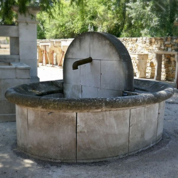 Garden fountain carved in natural stone from a regional quarry.