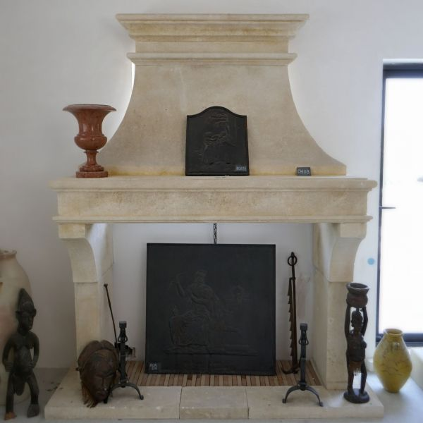 Large fireplace crafted in natural stone of Louis Phillipe's style  for your house.