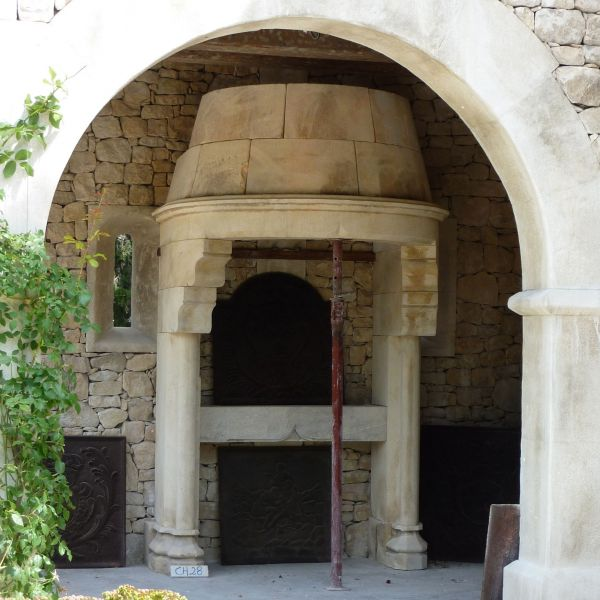Eye Catching Gothic fireplace in carved stone made by stone mason craftfirm from Vaucluse