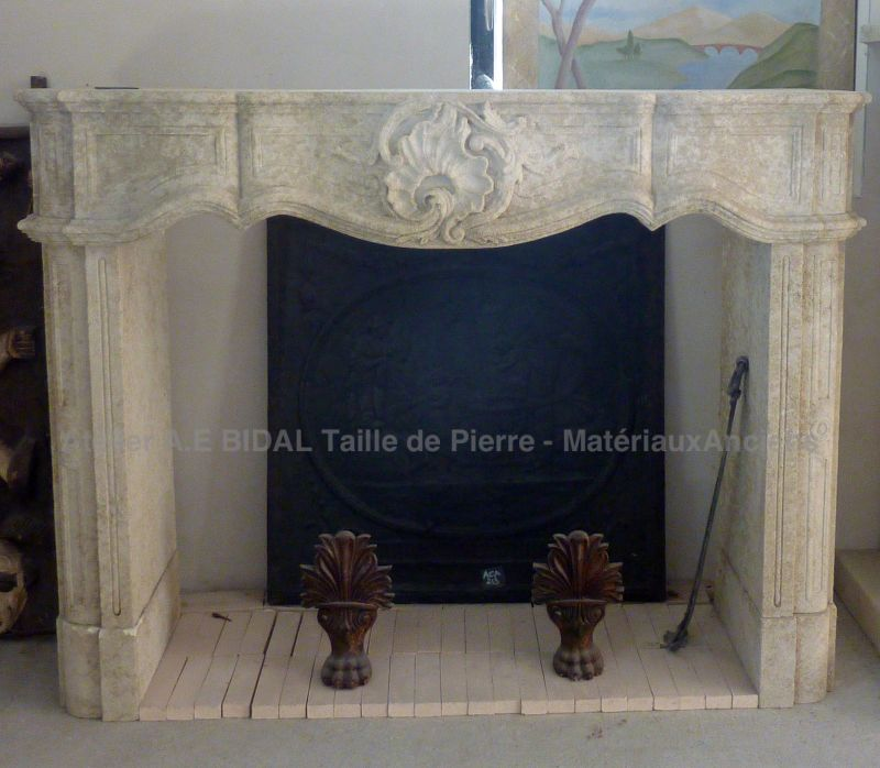 Fireplace in a Louis XVth-style handmade in carved limestone from French quarry.