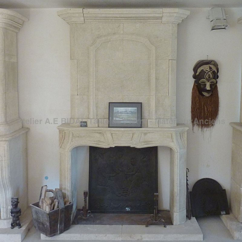 Louis XIVth style fireplace, a crafted limestone mantel that first started in Provence.