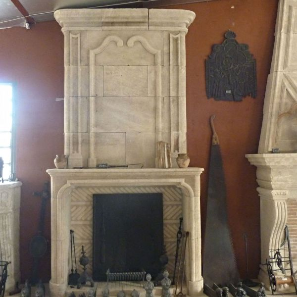 Fireplace carved in Provence limestone - a creation by Alain Bidal.