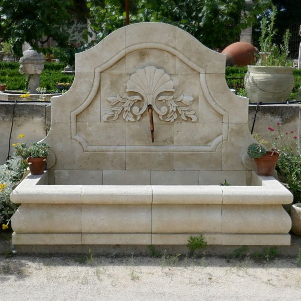 Wall fountain in limestone  made by our stonemason in Provence.
