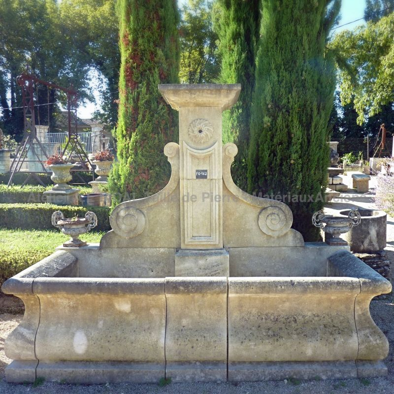 French garden wall fountain in natural limestone from the provencal Alain BIDAL.