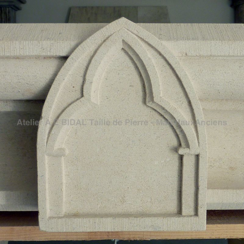 Neogothic style fireplace carved by hand by Atelier Alain BIDAL, Provence.