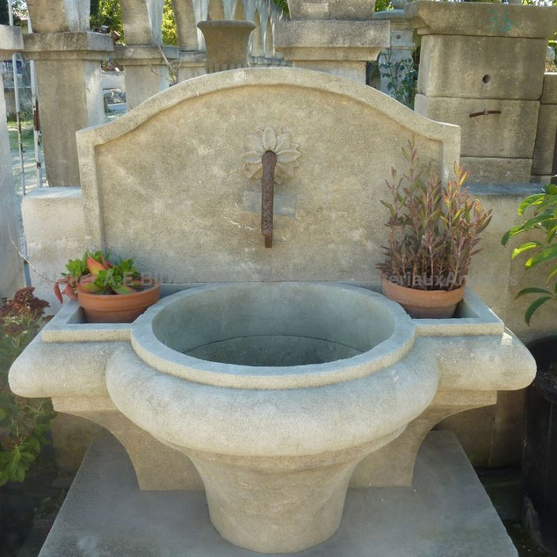 Garden fountain with 3 basins - one big basin and two small ones.