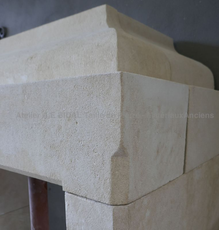 Detail of moldings and chamfers on our Provencal fireplace in natural stone.