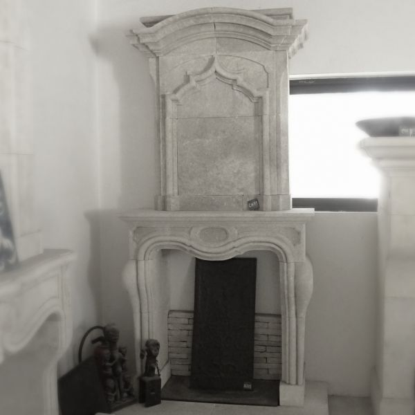 Fireplace with an overmantle, new edition of a fireplace in the style of Louis XV