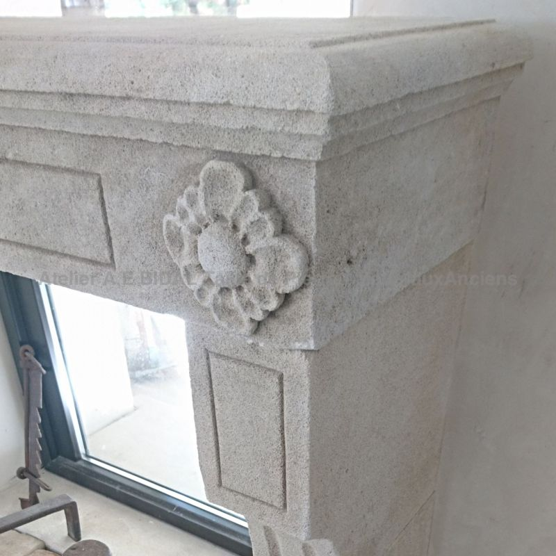 Detail of a fine sculpture on our fireplace Louis XVI floral style in natural stone.