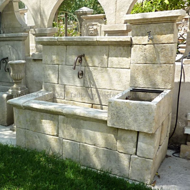 Large decorative Provence fountain carved in natural stone by the stonecutter Alain BIDAL.
