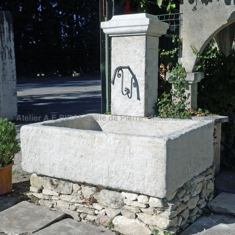 Wall fountain with a monolithic basin carved in natural stone from Provence - Water fountain by the Bidal workshop