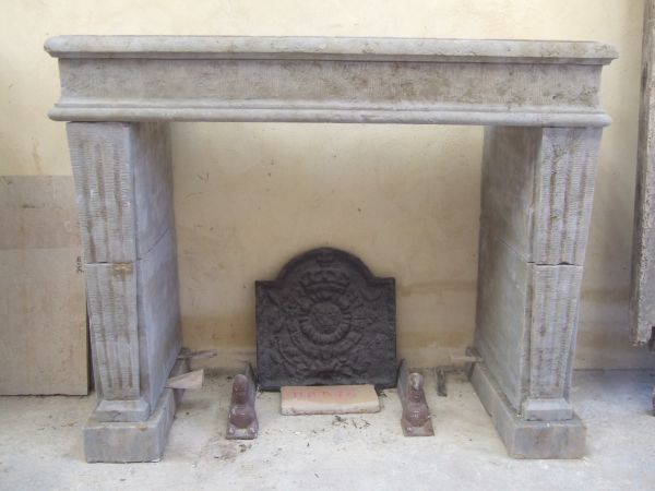 fireplace Louis XVI in carved stone from the Gard quarry