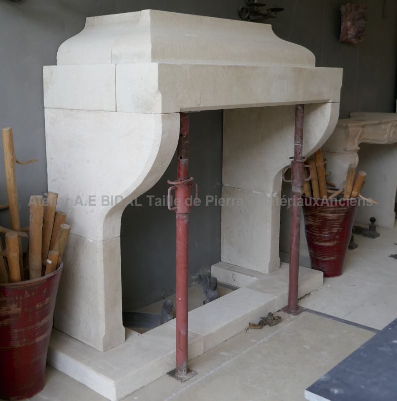 Hand carved fireplace in stone from Provence made by Alain Bidal