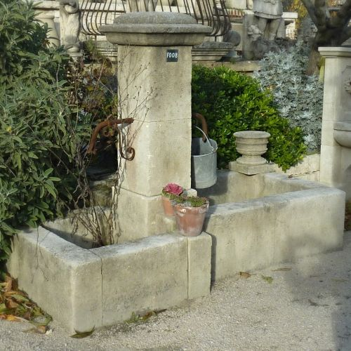 Rustic fountain - pretty element in stone for outdoor decoration