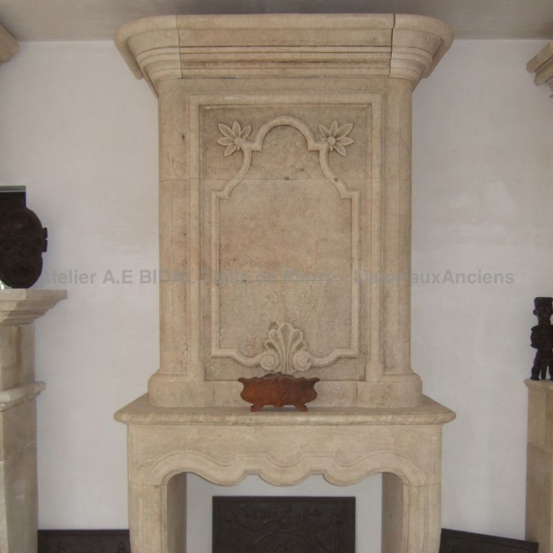 fireplace for insert  inspired by Louis XV, in carved stone