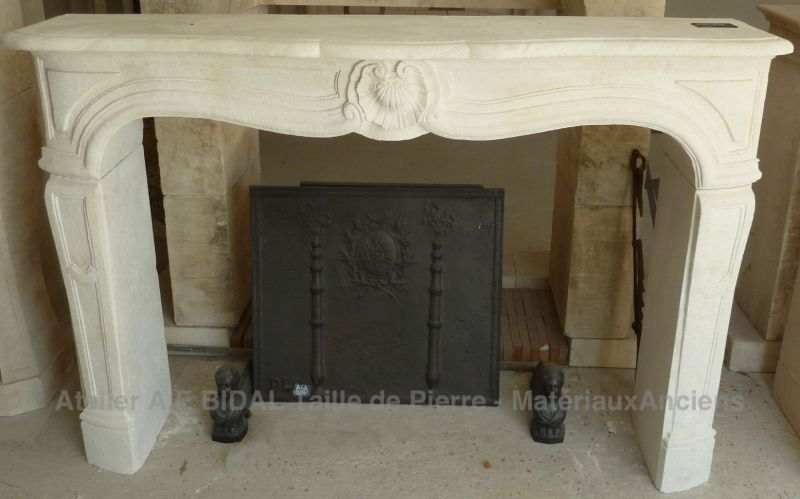 Stylish fireplace of French Regency style - a fine work of stone cutting.