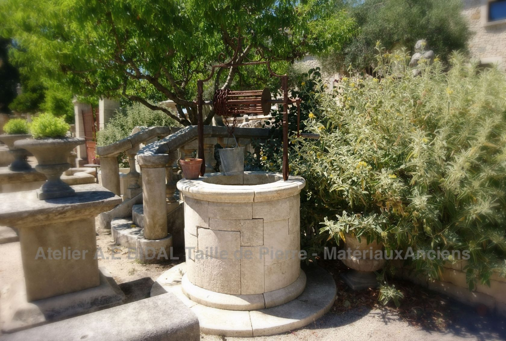 Here is a beautiful natural stone well made by Alain Bidal in his Atelier in Isle-sur-la-Sorgue.