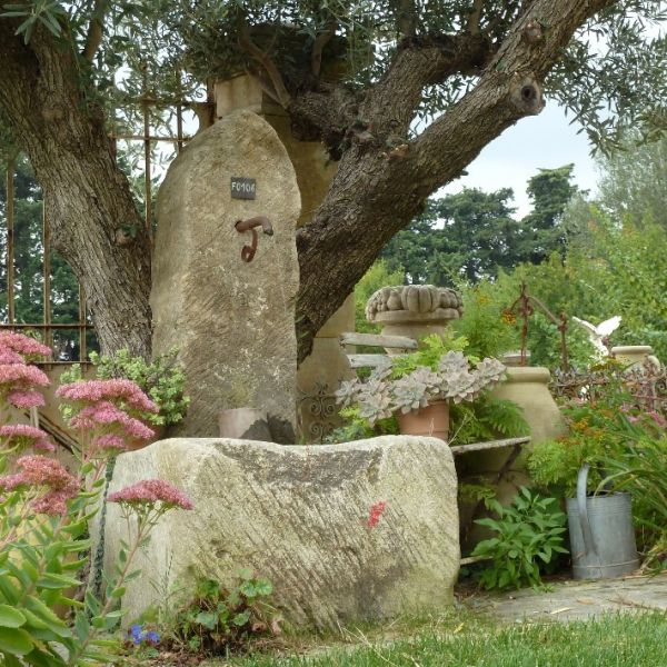 Small rustic style wall fountain - Stone water terminal in Provence stone.