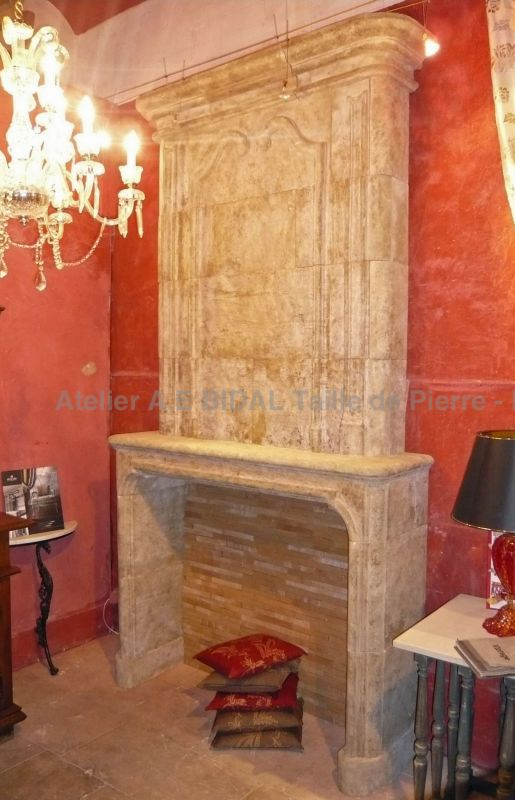 This limestone fireplace is a beautiful element of indoor design of the Louis XIIIths tyle.