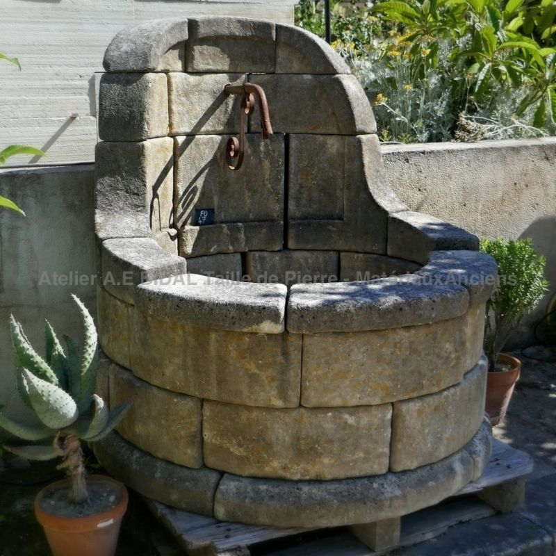 French garden fountain inspired by the Provencal wells of yesteryear.