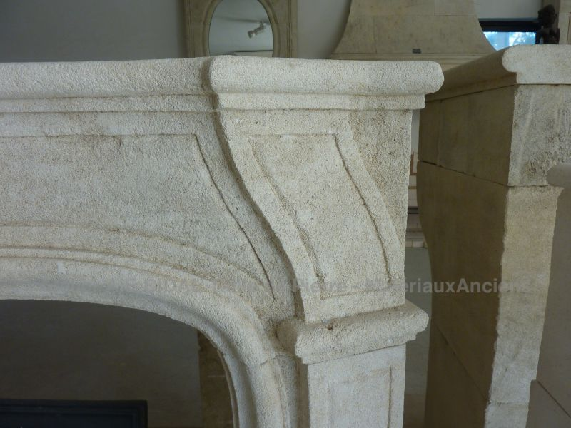 Stone fireplace in the Louis XV style - a French crafted fireplace.