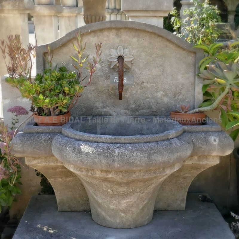 Cheap garden fountain in French limestone by the stone cutter craftsman from Provence Alain BIDAL.