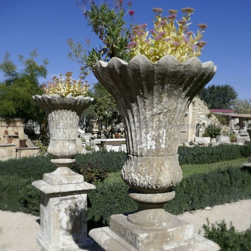 Vase in stone in a tulip form by the Bidal workshop in Provence