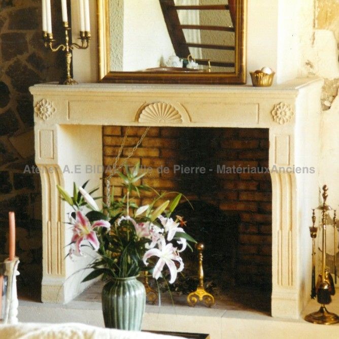 Louis XVI style fireplace -  A stone fireplace crafted by a master stone cutter in Provence.