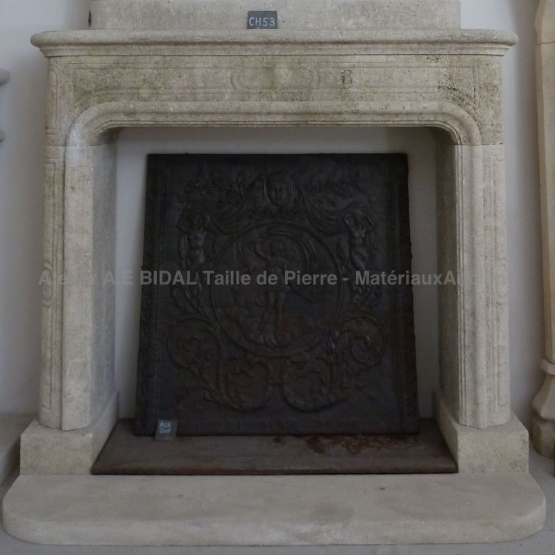 Old fashion fireplace in Louis XVI style in natural stone from french quarry