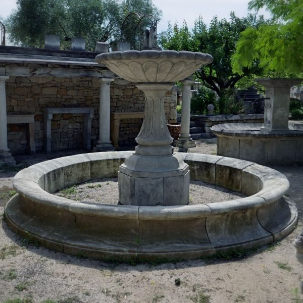 Beautiful village fountain carved in stone | A Traditional provincial stone fountain.