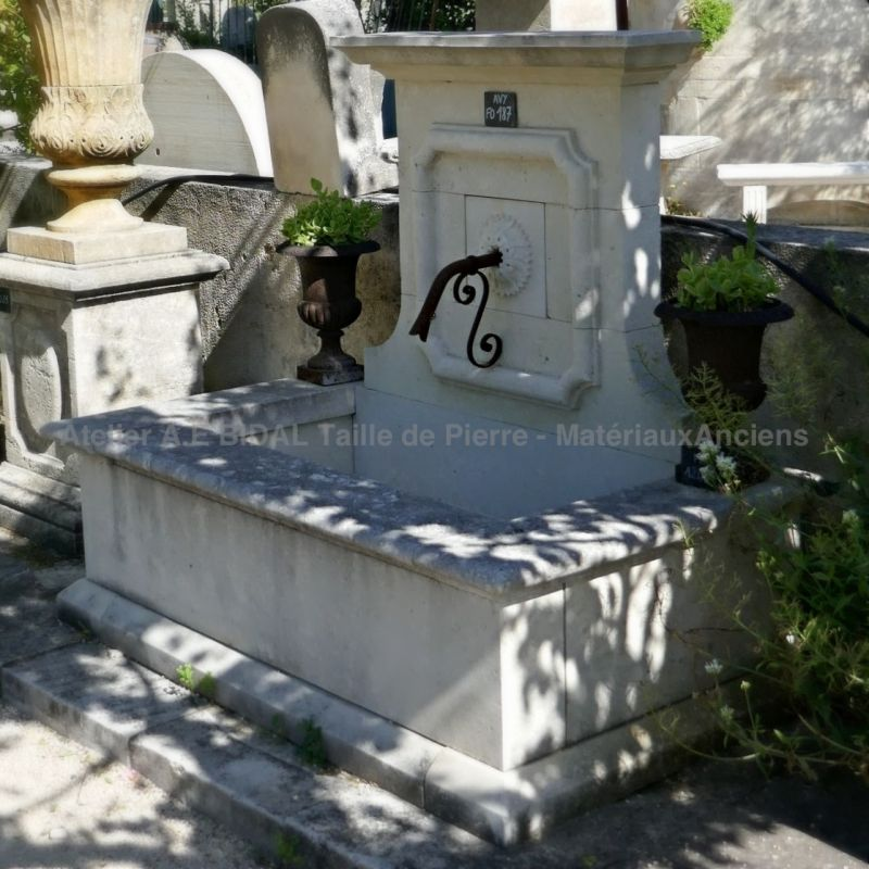 Provencal wall fountain in stone - Handmade stone fountain carved in the natural stone of Avy.