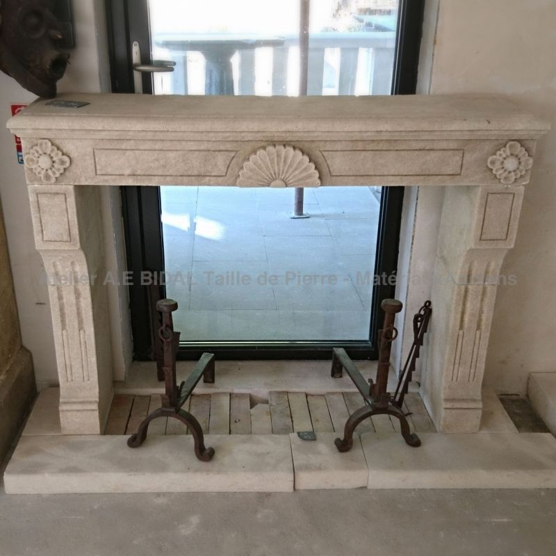 Bidal Workshop  - Louis XVI fireplace carved in a natural French limestone - a small size stone fireplace.