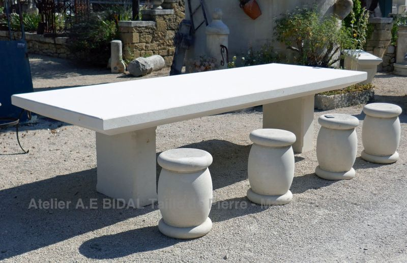 Furniture and decoration in stone: stone table for inside or outside.