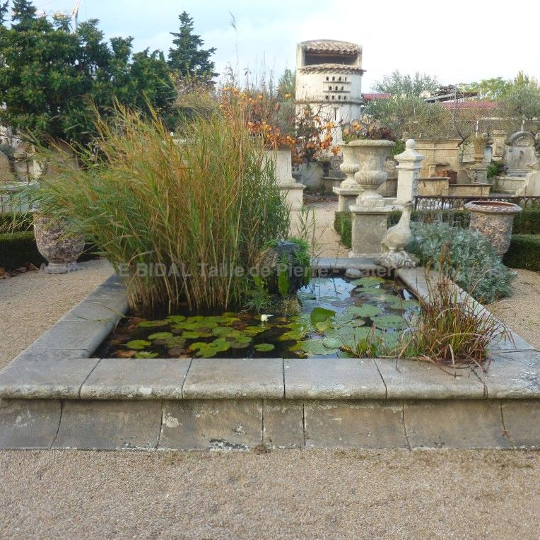 inspired by a village fountain, a very pretty garden pond in stone