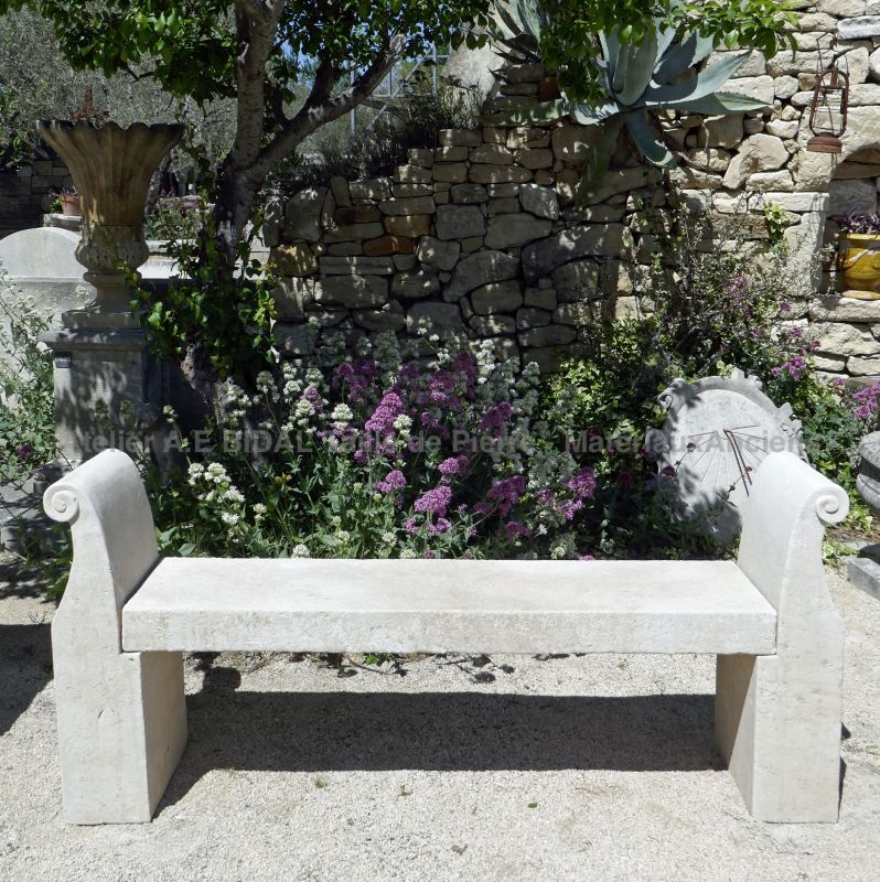 Beautiful garden bench carved in Avy stone with sculpted armrests - Hand-crafted by Atelier Alain BIDAL
