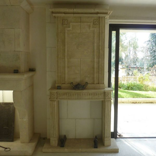 fireplace in carved stone in Louis XV style by craft firm Bidal