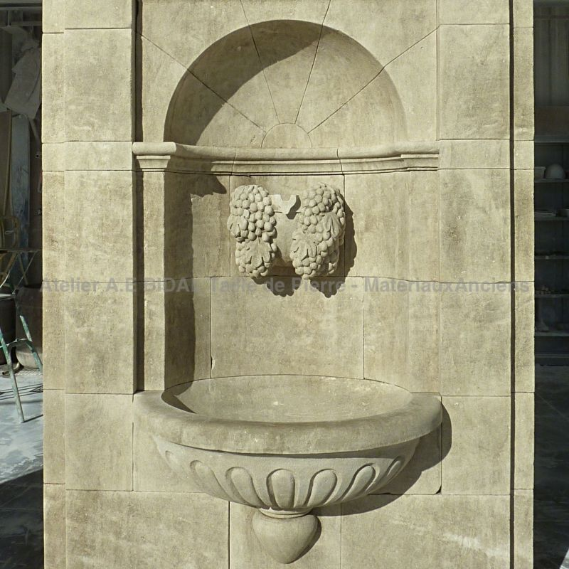 Stone fountainm Sculpted wall fountain