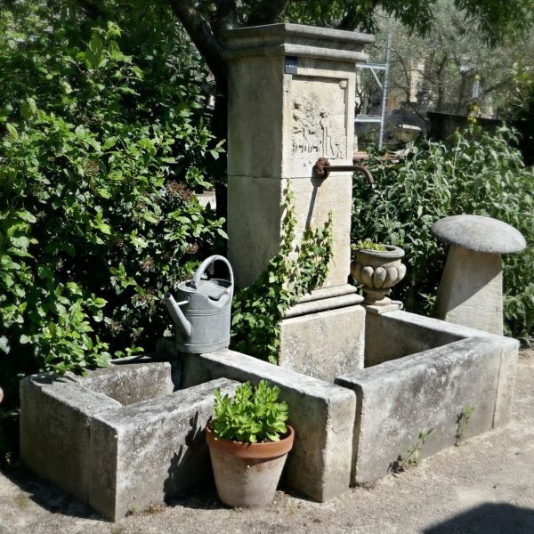 Garden fountain in a rustic style in natural stone - Stone mason Alain Bidal