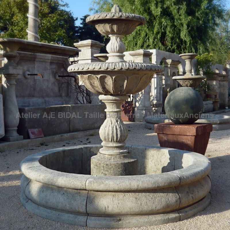 Beautiful central stone fountain with round basin and 2 overflowing bowls.