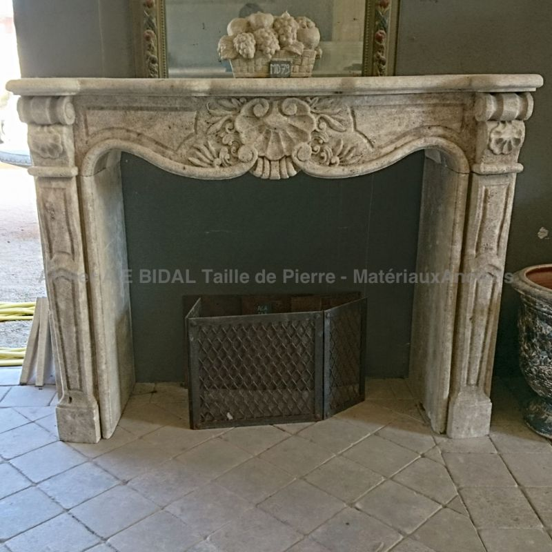 Pretty fireplace in Regency style in a natural stone carefully carved in Provence