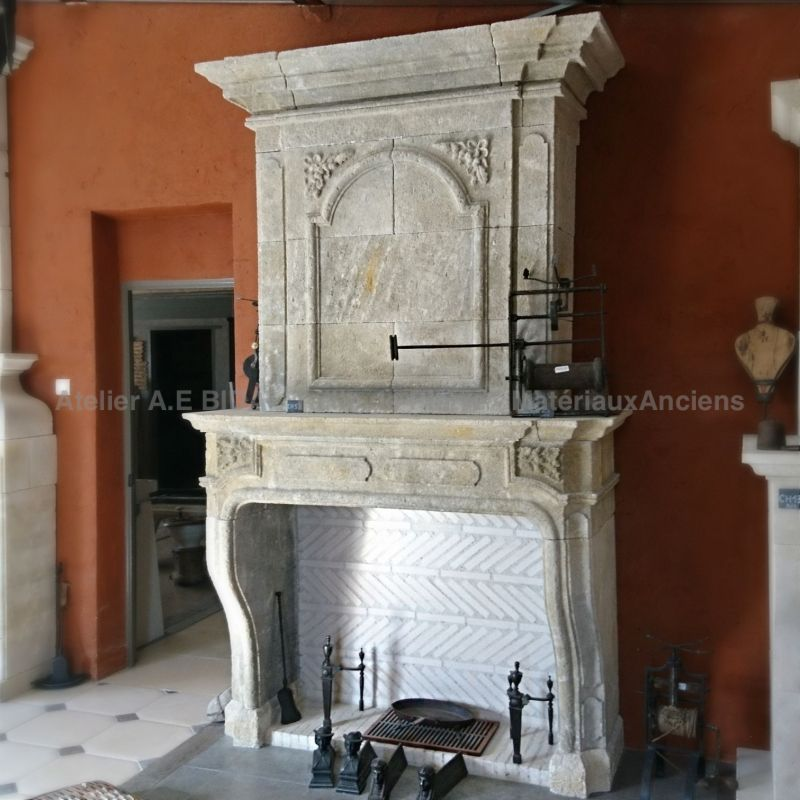 Louis XV style fireplace crafted in Estaillades Provence stone
