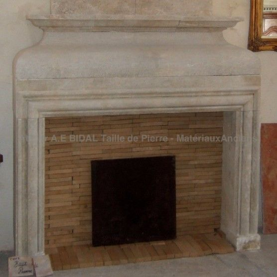 Beautiful Louis XIII fireplace in Estaillades stone with trumeau.