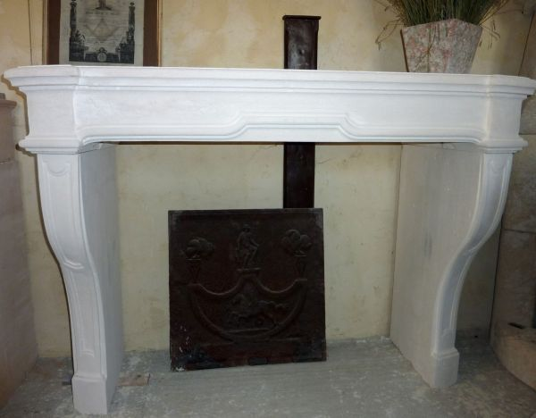 fireplace in a Louis XIV style in natural stone made in Estaillades stone