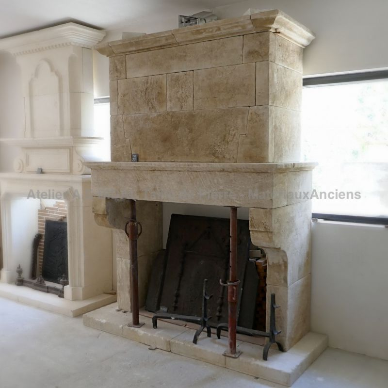 Antique stone fireplace crafted in Isle sur la Sorgue in Provence - Atelier Alain Bidal.