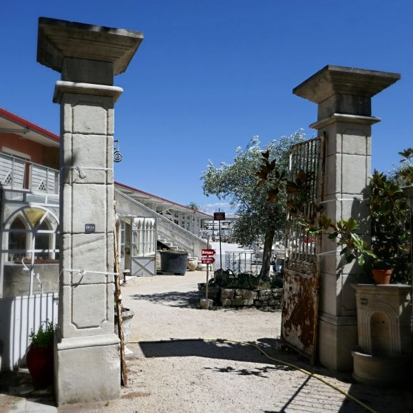 Pair of limestone pillars - an architectural element crafted successfully by our stonemason Alain Bidal